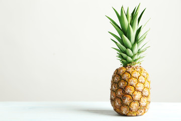 Ripe pineapple on a white wooden table Wall mural