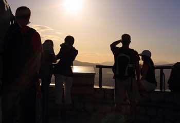Silhouettes of  tourists at sunset, Lycabettus Hill, Athens, Greece.