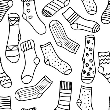 Vector seamless pattern of doodle socks for web design, prints etc. Repeating background can be copied without any seams.  Invitation, postcard, banner.