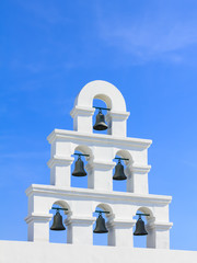 White bell tower santorini style with clear blue sky