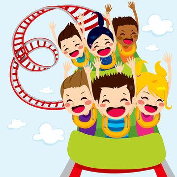 Happy children enjoy roller coaster ride screaming and having fun
