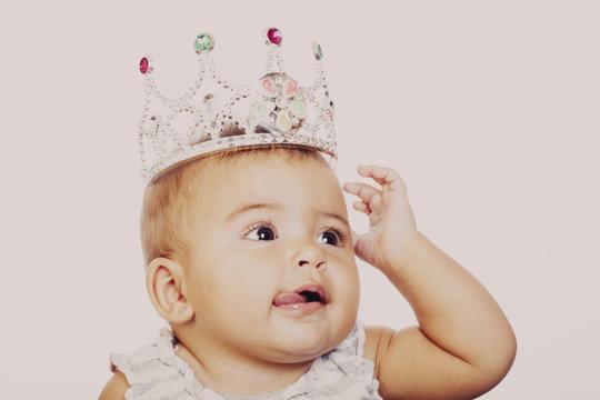 Close-up of little girl wearing fancy crown