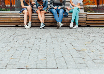 Teens hanging out on the bench