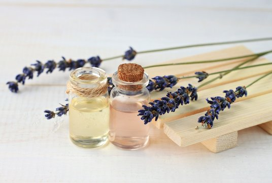 Lavender relaxing remedy. Aroma water and oil in bottles with lavender twigs.