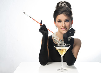 Woman in sunglasses, like a movie star, drinking martinis