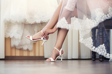 the bride puts on shoes  feet
