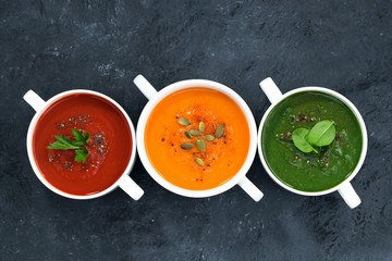 assortment of fresh vegetable soup on a dark background