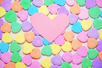 Candy hearts with a blank pink heart on top, can be used to add a message