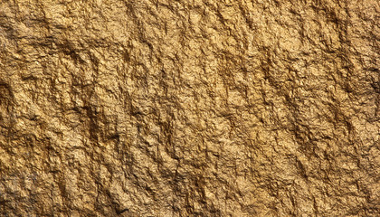 Texture of stone painted with golden color