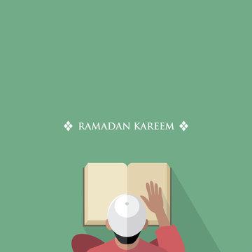 Muslim man reading the Quran book