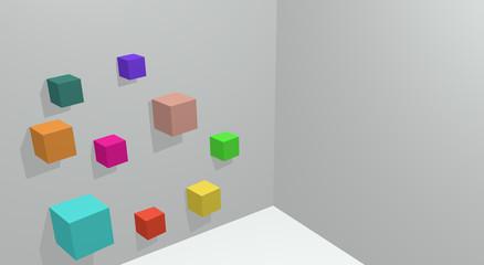 Cubos coloridos em parede branca