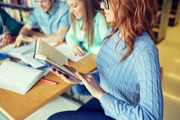 close up of students reading books at school