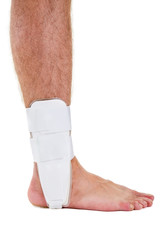 Profile of Man with Bare Foot Wearing Ankle Brace.