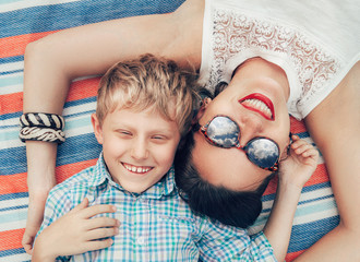 Happy smiling mother and son portrait