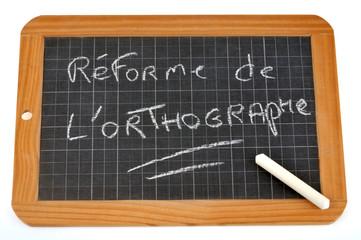 Réforme de l'orthographe écrit sur une ardoise