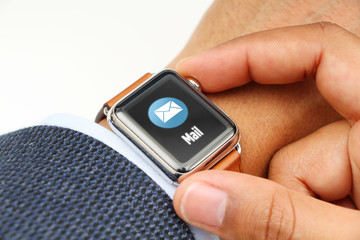 Business' man checking e-mails with a smart watch app