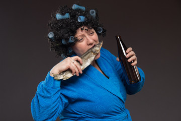 Female alcoholism. Lonely poor fat woman aged drinking beer and