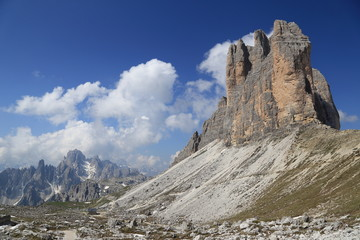 Tre Cime peaks, surrounding mountains and clouds