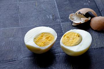 Hard boiled egg halves and shell landscape side
