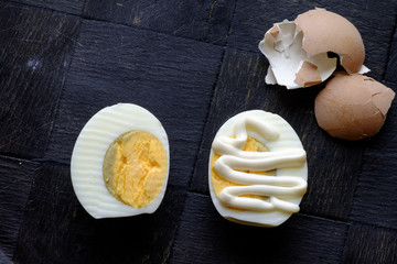 Hard boiled egg halves with mayonnaise landscape top