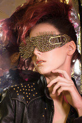 \young girl with red hair wearing glasses with gold spikes in th