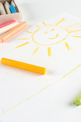 Child's drawing of a smiling sun.