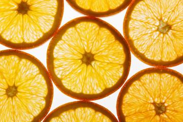 slices of orange on a white background