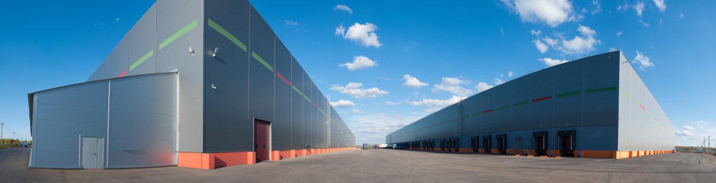 Panorama of big industrial warehouse buildings