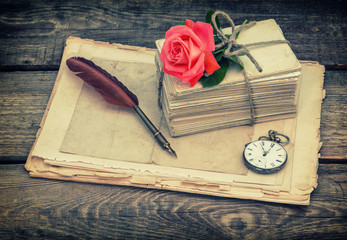 Old postcards and letters with red rose flower