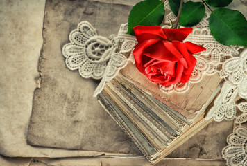 Old love letters, red rose flower, lace vintage toned