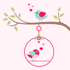 lovely bird on a swing on a branch