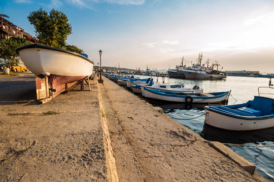 fishing boats in port of Sozopol  at sunset