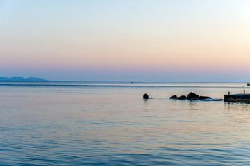 Impressive colorful sunset in Mykonos, Greece.