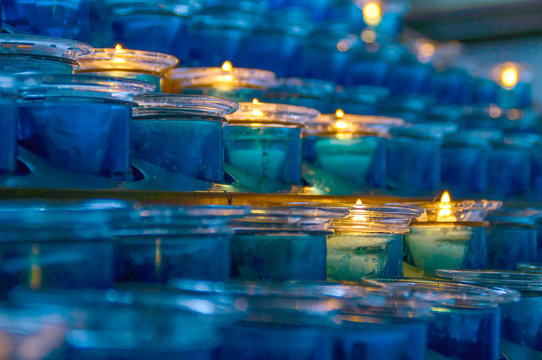 Dark artistic blue glass votive candles with selective focus