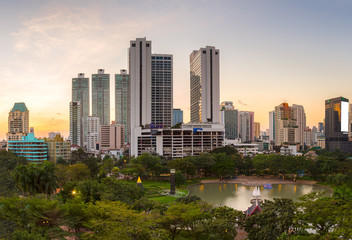 Bangkok business district with the public park area in the foreg