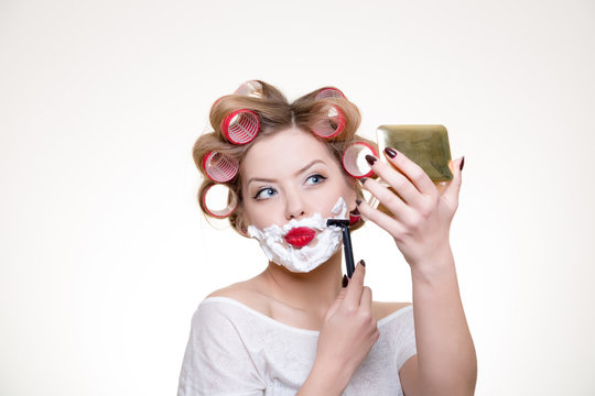 funny woman shaving face and seeing into mirror