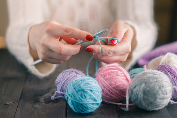 woman's hand knitting scarf, handcraft.