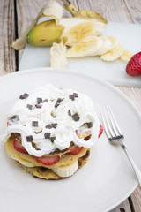 pancakes with strawberries, banana, blueberries and chocolate...