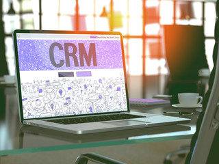 CRM - Customer Relationship Management - Concept - Closeup on Landing Page of Laptop Screen in Modern Office Workplace. Toned Image with Selective Focus. 3d Render.