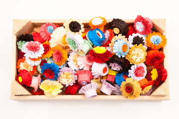 Small, colorful paper flowers made with quilling technique