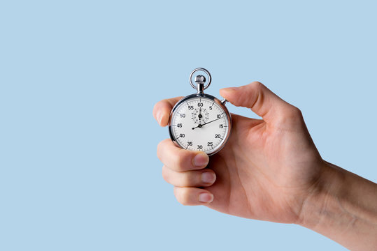 timer held in hand, blue background