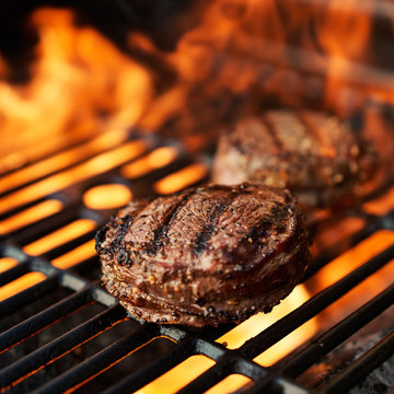 flaming hot grill cooking bacon wrapped filet mignon