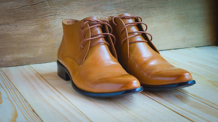 classic brown oxford shoes on wooden background