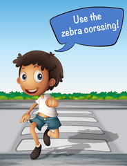 Boy crossing the road using zebra crossing