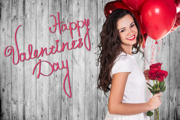Happy Valentines Day on a gray wooden wall