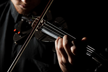 Close-up photo of man playing electric violin