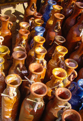 Tall orange and blue Mexican pottery