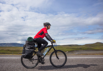 Happy biker ride on road in Iceland. Travel and sport picture