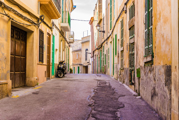 Fototapete - Old town street with ancient rustic mediterranean houses