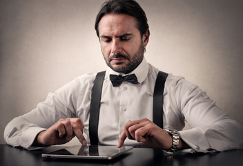 Gentleman using a tablet